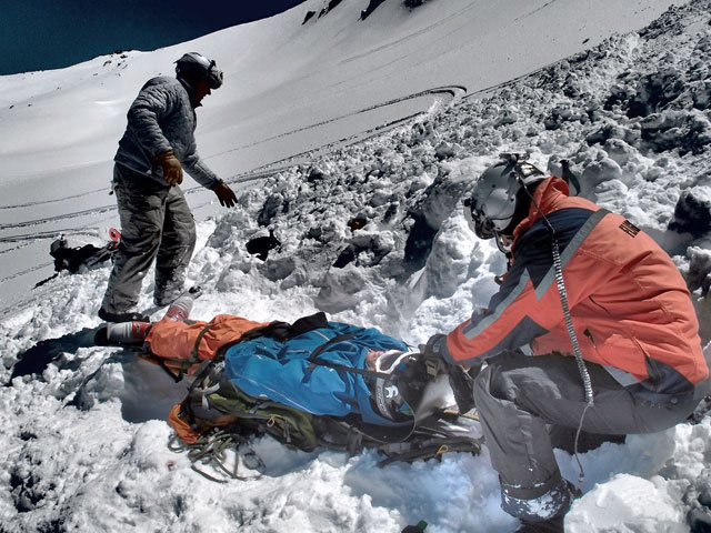 Chris Hendrickson, left, and Flight for Life paramedic Tag Hopkins, right, on scene with Nick DeVore following his femur-breaking avalanche accident last week deep in the backcountry south of Aspen. Photo: Ian McLendan