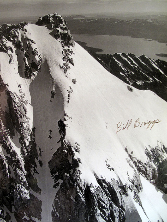 As the story goes, when news of Bill Briggs' June 15, 1971 first descent of the Grand Teton reached Jackson-town, local newspaper woman Virginia Huidekoper, somewhat disbelieving, went up for a flight over the peak to see for herself. The result is this iconic photograph showing Briggs' unlikely tracks. Photo: Virginia Huidekoper