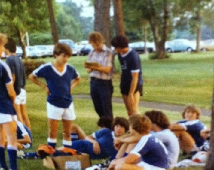 David Taylor, center, coaching my brother's soccer team while rocking a perm