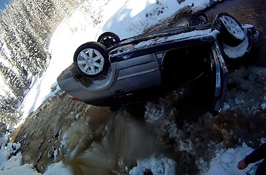 One of Graham's recent flips didn't end well—that is, in a creek off the Silverton Mt. access road. Photo: Suz Graham