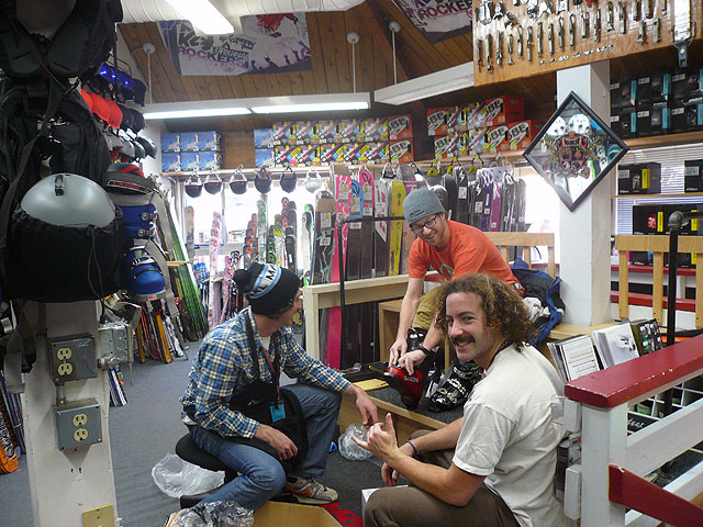 Sports Shop employees Brent Osborn and Dan Forsythe help a customer try on boots recently. Photo: Melissa Siig