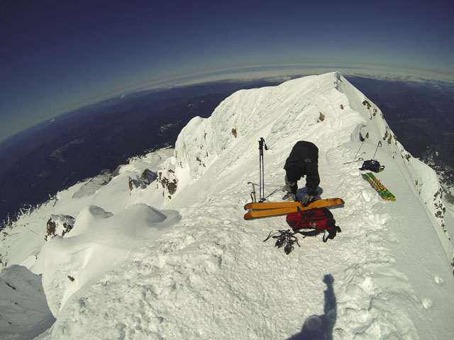 The hippy killer quietly removes his stilettos and prepares for the descent back to the terrain park. PHOTO: Ethan Stone