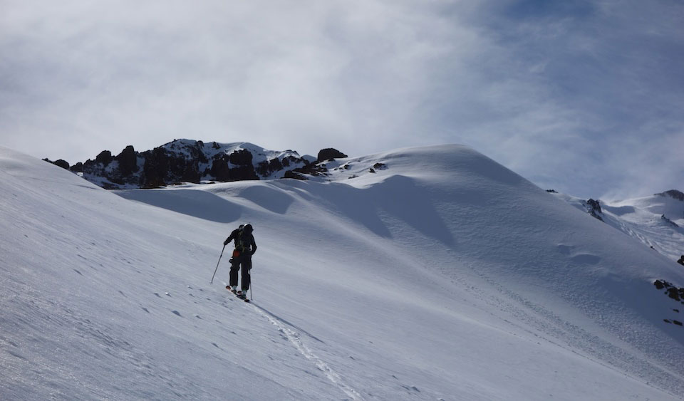 Drew Tabke hiking in Nevados de Chillan, searching for September skiing. PHOTO: Griffin Post