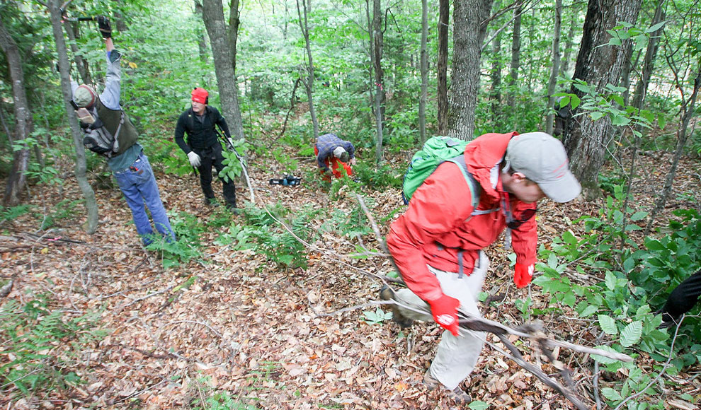 Volunteers trim dense forests for one goal, skiing. PHOTO: Brian Mohr/EmberPhoto