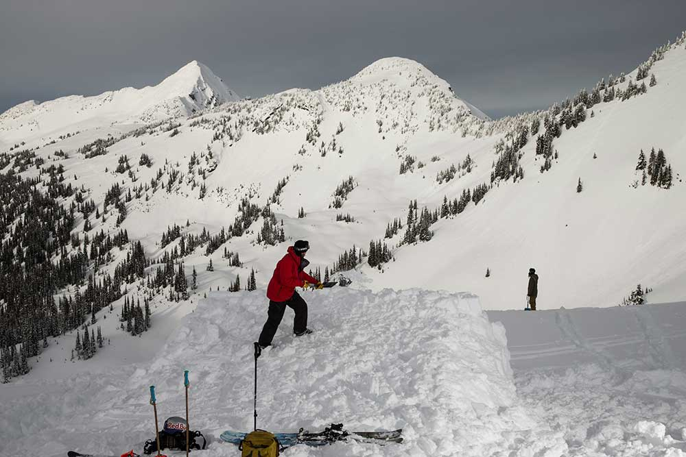 Riley Leboe shoveling away on January 9 to build the slopestyle venue for the Red Bull Cold Rush at Revelstoke, B.C. PHOTO: Bryan Ralph/Red Bull Content Pool