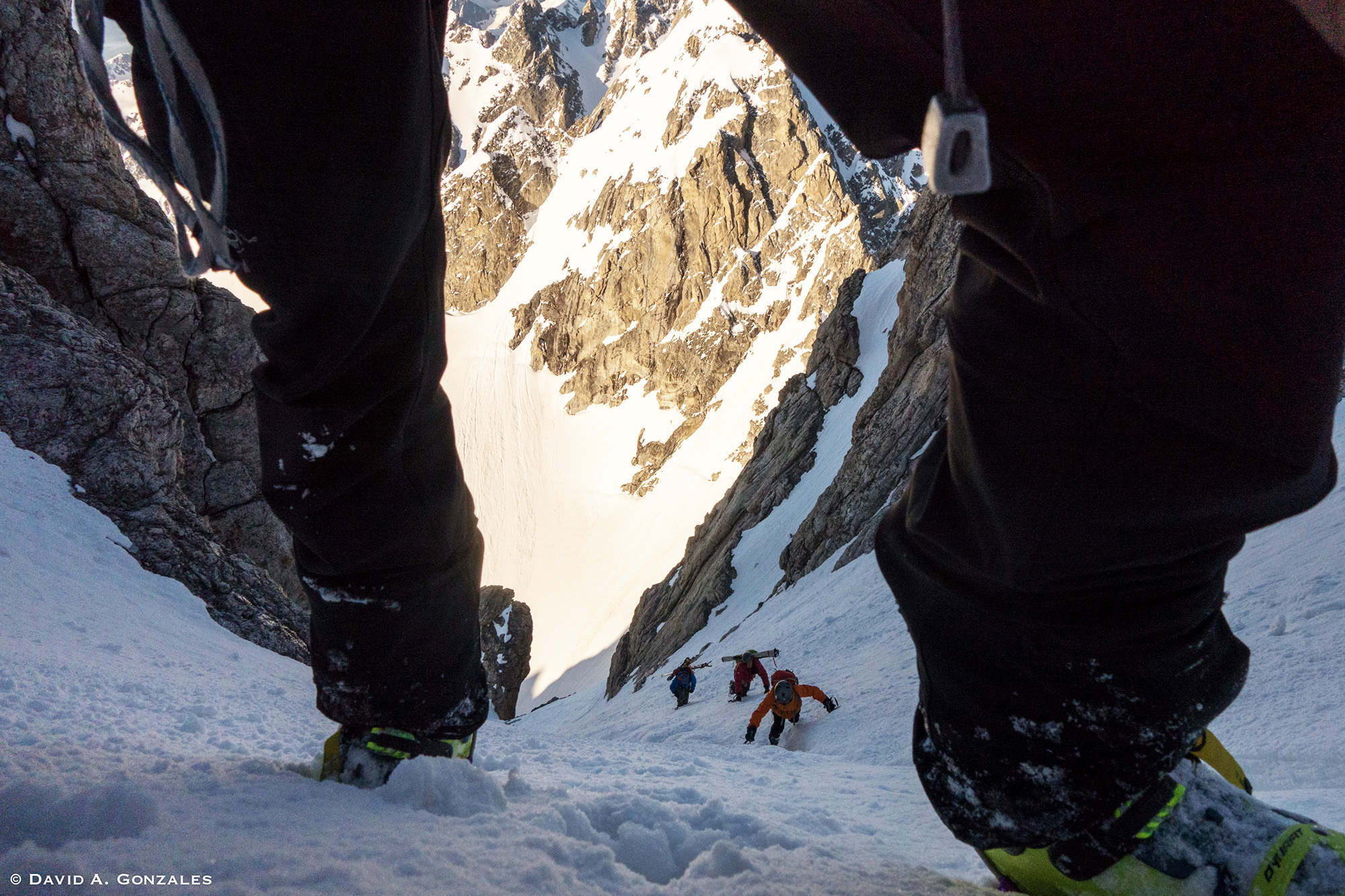David Gonzales gets a nice view of Sasha, Hans, and Nancy Johnstone as they punch up the firm snow in the Grand Teton's lower Stettner Couloir.