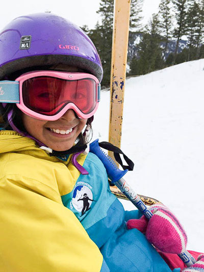 "Deyna Lira, 10, flashes a smile during her Saturday morning ski lesson at Snow King. She says she loves wipe-outs the most and she said, ""I like it when snow flies over my head."" PHOTO: Danielle Shapiro"