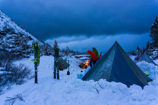 Early in May, the crew prepares for a fast-approaching storm at high camp before skiing Pigeon Peak and Turret Peak. PHOTO: Ian Fohrman