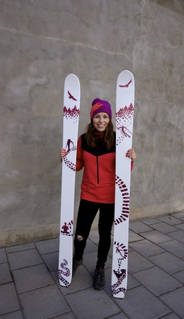 Sandra Fransson holds skis with her design depicting Andreas overcoming his fears, moving toward the mountains. PHOTO: Courtesy of Sandra Fransson.