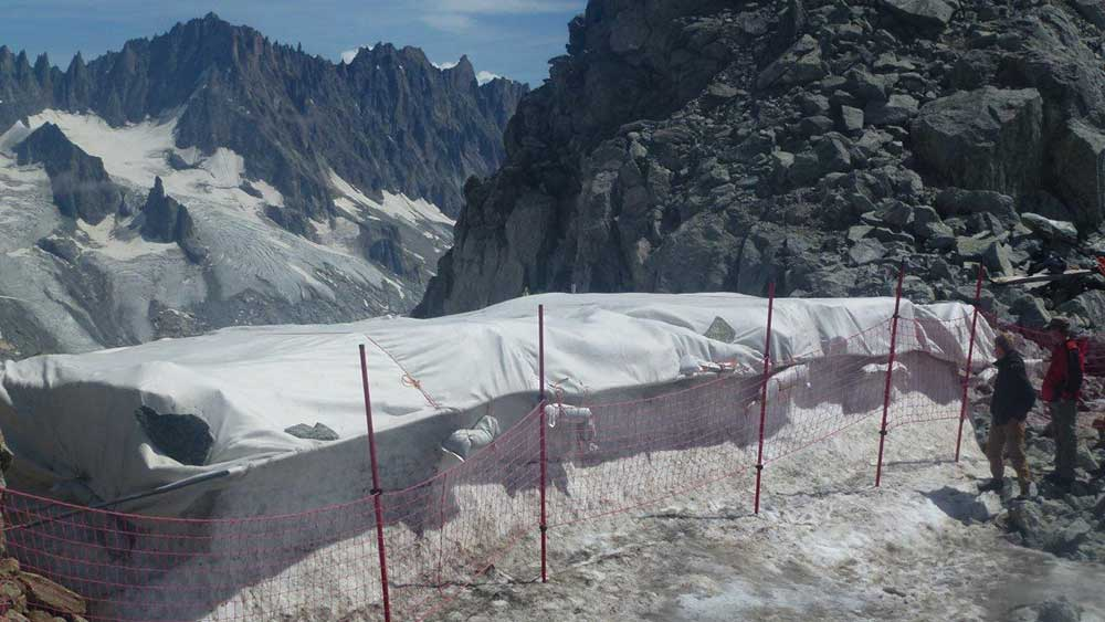 For the fifth summer, resort officials at Grands Montets covered the Rognon Glacier with a tarp, in an attempt to slow the rapid acceleration of snowmelt that is happening across the Alps. PHOTO: Luc Moreau