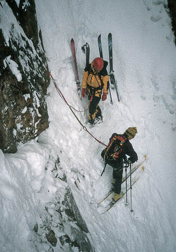 Hans Saari and Alex Lowe gearing up to ski the Becky/Chouinard Route in Montana. Both men were influential in climbing and skiing. Unfortunately, they paid the ultimate price to pursue their respective paths, Lowe passing in 1999, and Saari in 2001.