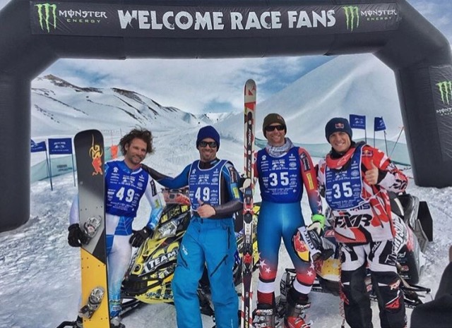 Skiers at a finish line.