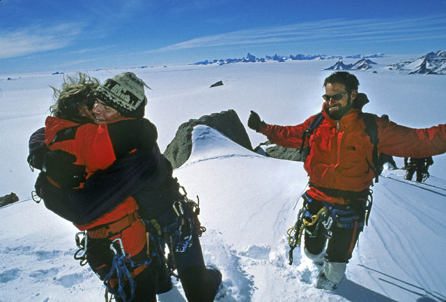 Alex Lowe hugs Conrad Anker atop Rakekniven Spire, Antarctica. Jon Krakauer is on right. Photo: Gordon Wiltsie
