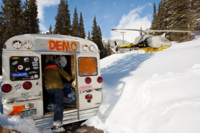 Skiers at the infamous Demo Bus, aka gear storage at Silverton. PHOTO: Greg Von Doersten