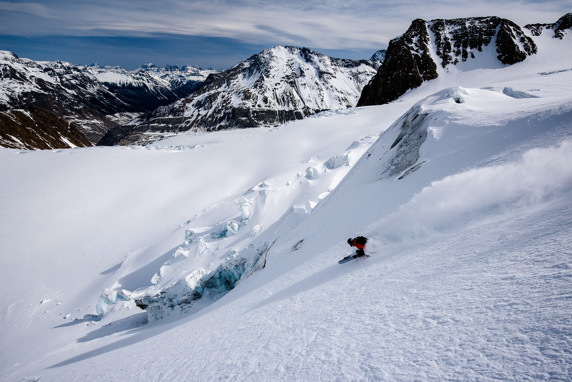 Lustenberger pursues the fall line in the Freshfields Glacier, on the border between BC and Alberta.  PHOTO: Bruno Long