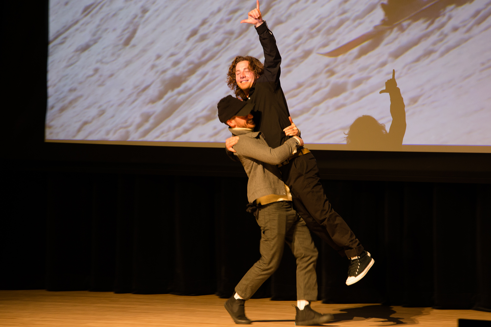 Sean Pettit carries Sammy Carlson onstage to accept the award for Best Male Performance. PHOTO: Liam Doran