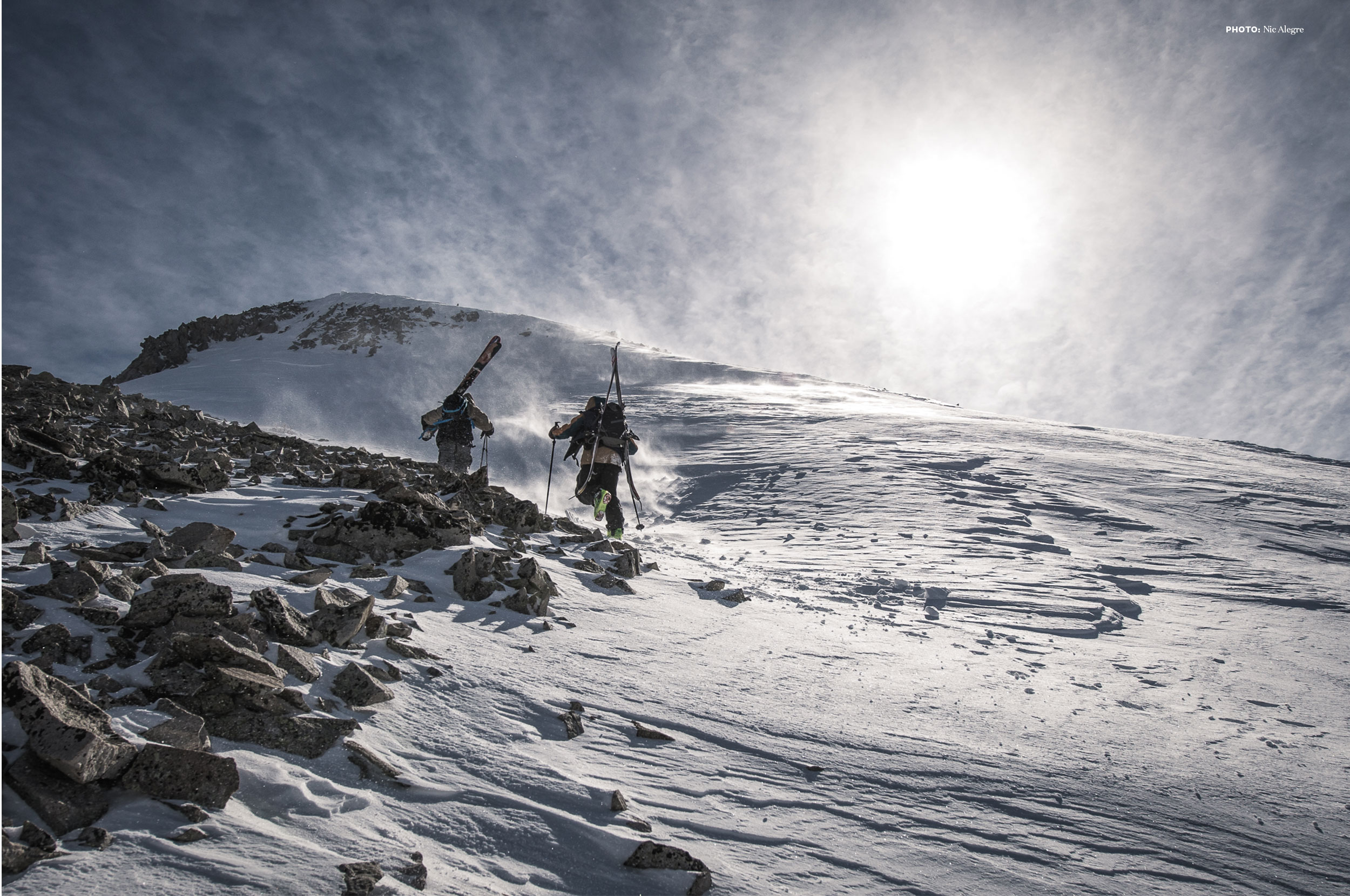 Skiers hiking up a mountain in the La Sals, Utah