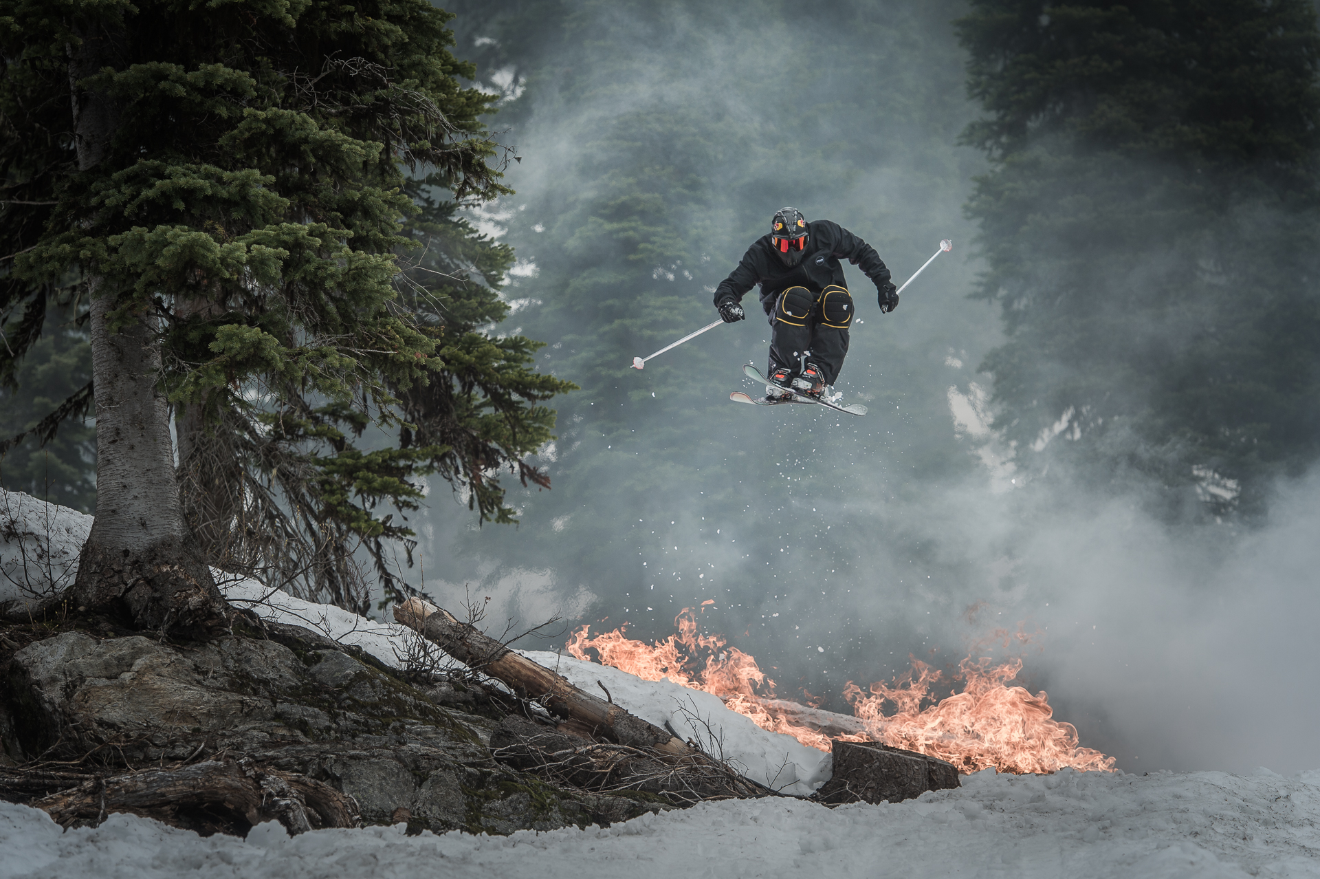 OK, make jumping fire look like the coolest thing ever, then a heli bump for pow, followed by some hobnobbing in the village, and then retire on the deck with some grappa. PHOTO: Blake Jorgenson