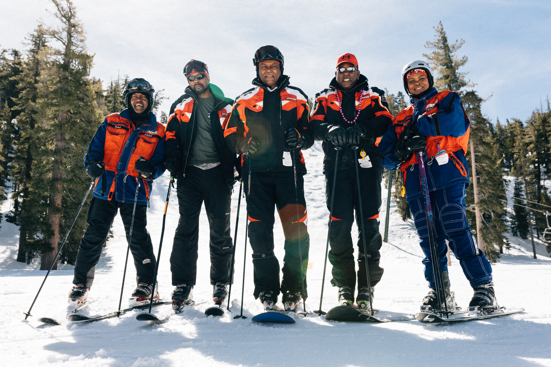 Members of Jim Dandy and All Seasons show the benefits to enrollment in a ski club: The best jackets in skiing, and the chance to make monoskiing cool again.