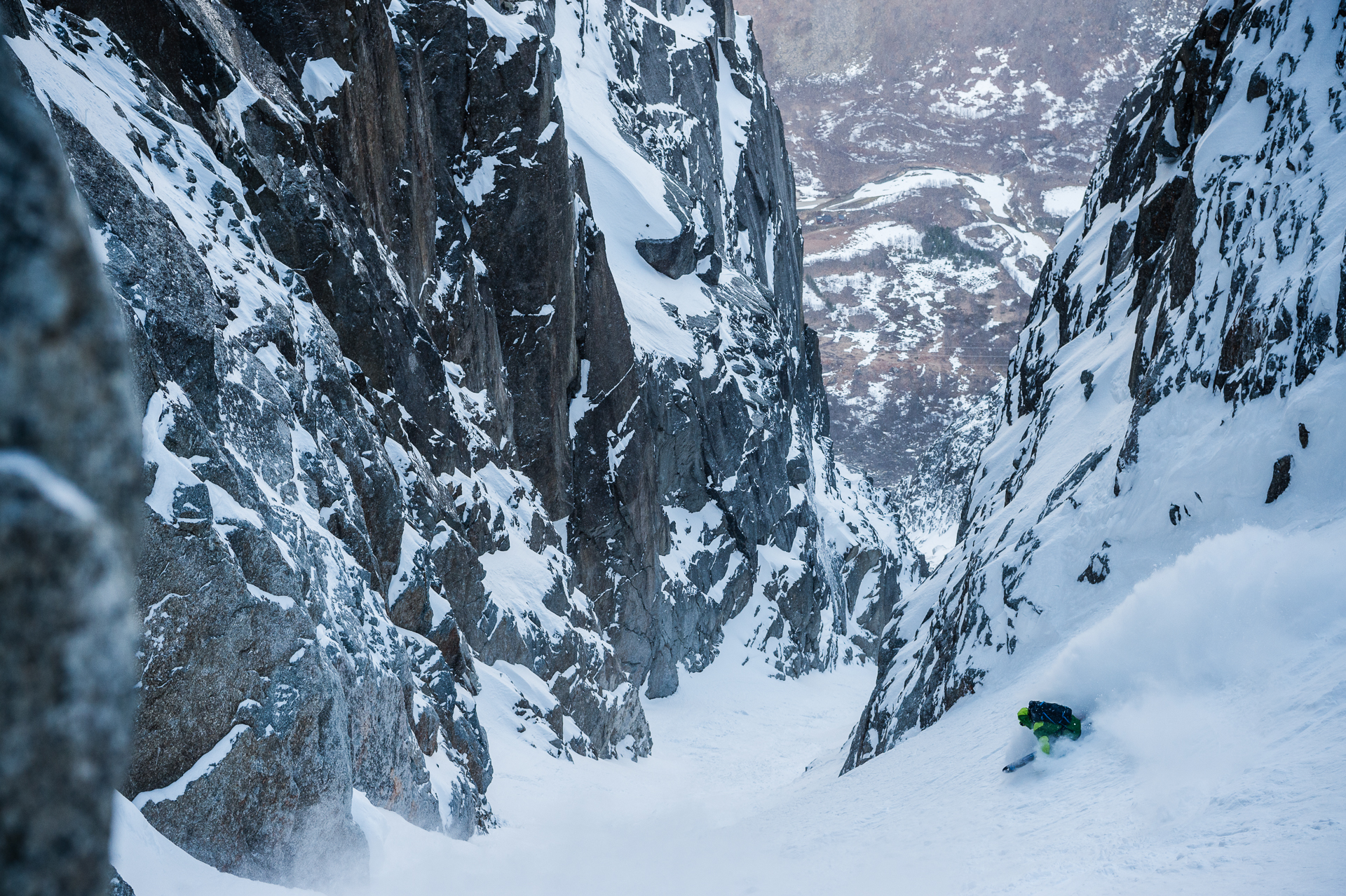 Chad Sayers skis the Skamdalsrenna in powder. Just days later, when the author arrived after a full day's approach, warming temperatures and rockfall turned the group around.